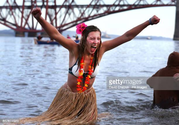 A swimmer takes part in the 'loony dook' New Year's Day dip in the Firth of Forth at South Queensferry as part of Edinburgh's threedaylong Hogmanay...