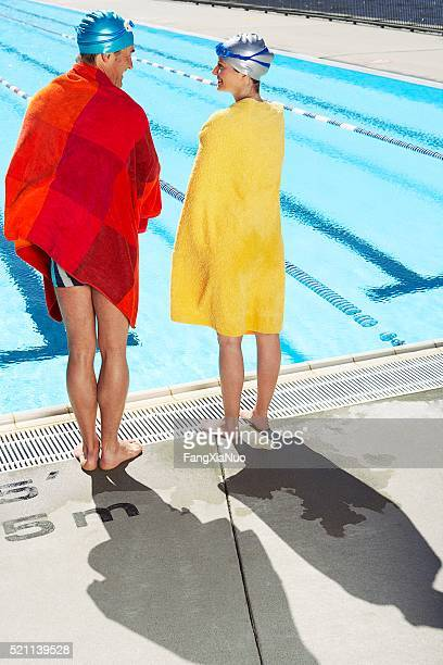 swimmer talking outside the pool - length stock pictures, royalty-free photos & images