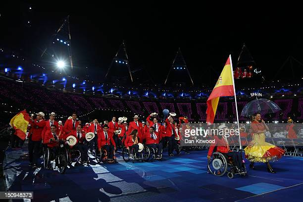 Swimmer Teresa Perales of Spain carries the flag during the Opening Ceremony of the London 2012 Paralympics at the Olympic Stadium on August 29 2012...