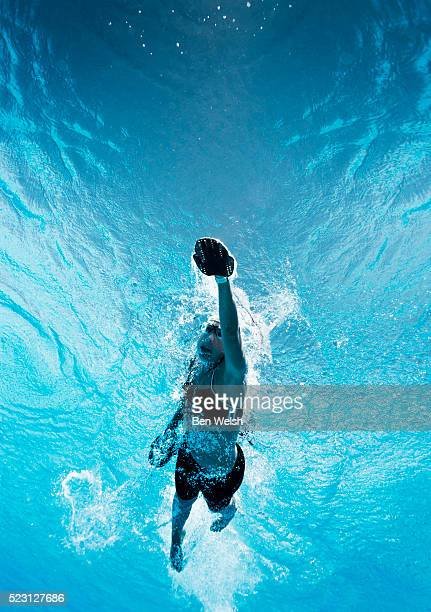 Swimmer training with swimming gloves