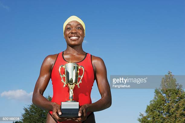 Swimmer with a trophy