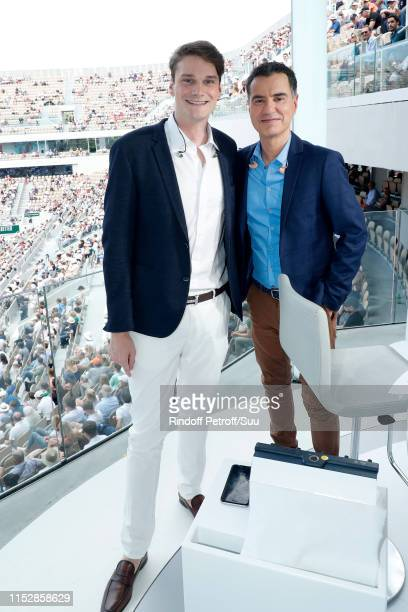 Swimmer Yannick Agnel and Sports Journalist Laurent Luyat pose at France Television french chanel studio during the 2019 French Tennis Open - Day Six...