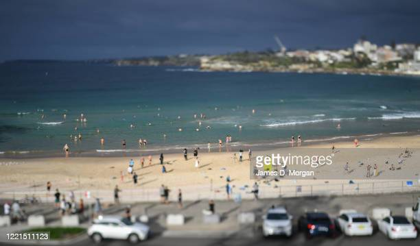 Swimmers and surfers return to the water at Bondi Beach on April 28 2020 in Sydney Australia Waverley Council reopened Bondi Bronte and Tamarama...