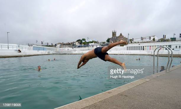 Swimmers at Jubilee Pool openair seawater lido on the morning it reopened to the public once again after the Covid19 lockdown on July 25th at...
