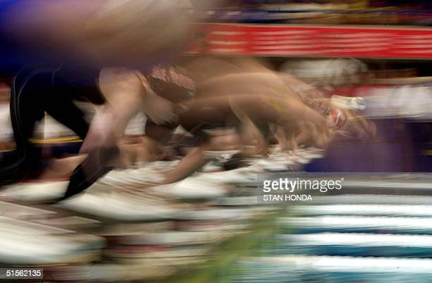 Swimmers at the start of the Women's 800m freestyle preliminary blur in this slow shutter speed exposure during the 2000 United States Olympic Swim...
