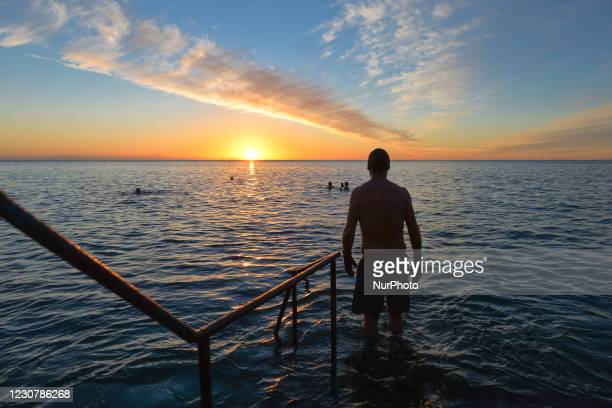Swimmers at the Vico bathing place, Hawk Cliff, in Dalkey, during Level 5 Covid-19 lockdown. On Monday, 25 January in Dublin, Ireland.