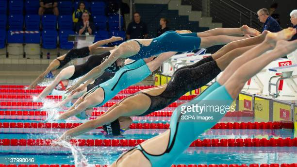 Swimmers begin the women's junior 50 metres freestyle final during Day 3 of the 2019 British Swimming Championships at Tollcross International...
