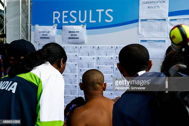 Swimmers check their results on day two of the Caixa Loterias 2014 Paralympics Swimming competition at Hebraica Club on April 25, 2014 in Sao Paulo,...
