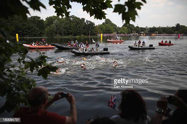 Swimmers compete during the Men's Marathon 10km swim on Day 14 of the London 2012 Olympic Games at Hyde Park on August 10 2012 in London England