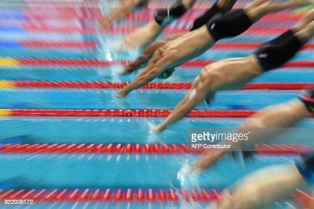 TOPSHOT Swimmers compete in a heat of the men's 50m breaststroke during the swimming competition at the 2017 FINA World Championships in Budapest on...