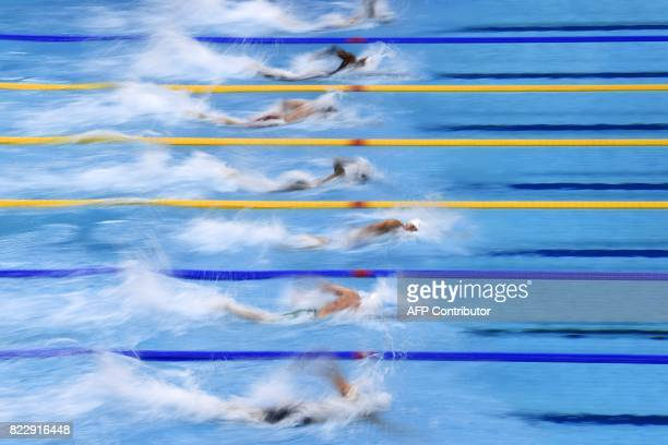 TOPSHOT Swimmers compete in a men's 100m freestyle heat during the swimming competition at the 2017 FINA World Championships in Budapest on July 26...