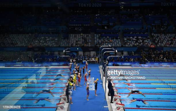 Swimmers compete in the final of the women's 4x100m medley relay swimming event during the Tokyo 2020 Olympic Games at the Tokyo Aquatics Centre in...