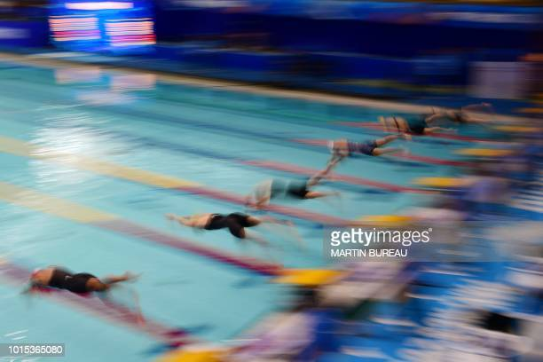 Swimmers compete in the heats of the women's 50m freestyle during the Pan Pacific Swimming Championships in Tokyo on August 12 2018