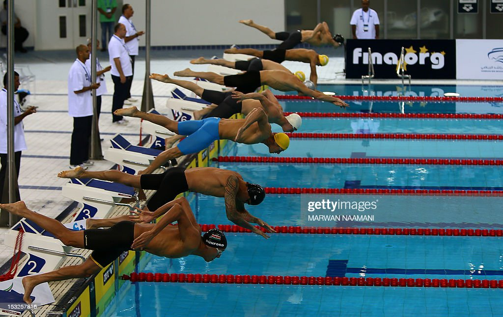 fa065078ca Swimmers compete in the men's 100 freestyle final in the FINA/ARENA ...
