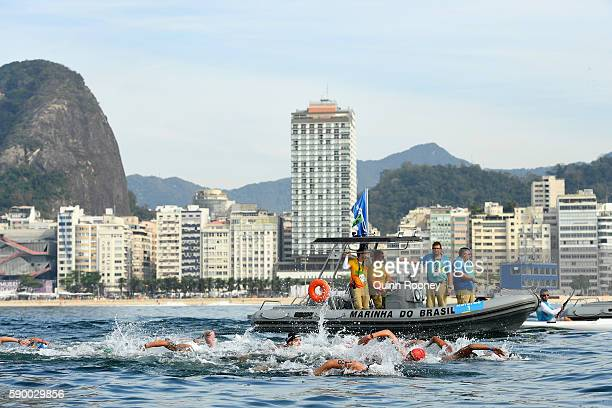 Swimmers compete in the Men's 10km Marathon Swim on Day 11 of the Rio 2016 Olympic Games at Fort Copacabana on August 16 2016 in Rio de Janeiro Brazil