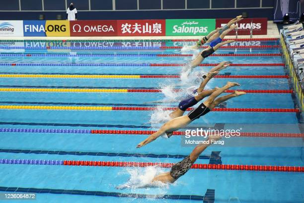 Swimmers compete in the Men's 200m Individual Freestyle Heats during day Three of the FINA Swimming World Cup Doha at Hamad Aquatic Centre on October...