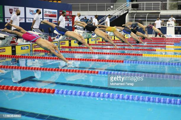 Swimmers compete in the Men's 50m Individual Butterfly Heat 2 during day Three of the FINA Swimming World Cup Doha at Hamad Aquatic Centre on October...
