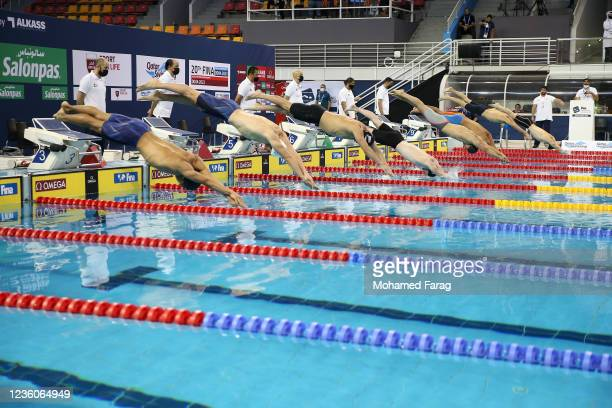 Swimmers compete in the Men's 50m Individual Butterfly Heat 3 during day Three of the FINA Swimming World Cup Doha at Hamad Aquatic Centre on October...