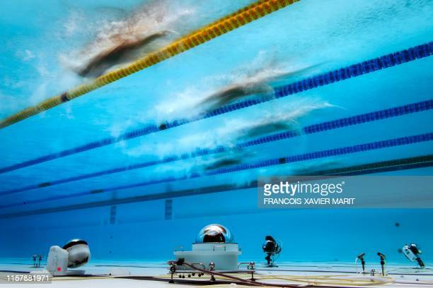 Swimmers competes in a heat for the men's 1500m freestyle event during the swimming competition at the 2019 World Championships at Nambu University...