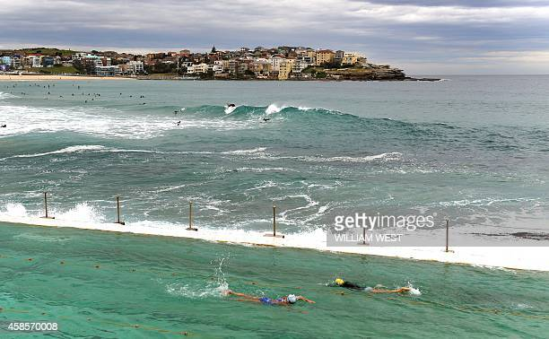 Swimmers complete laps at Bondi's Icebergs one of country's largest and bestknown swimming clubs boasting 1000 members 400500 of whom compete every...