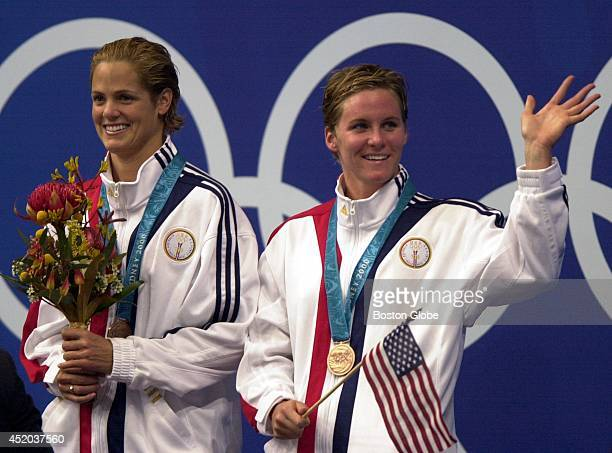 S swimmers Dara Torres left and Jenny Thompson right tied for the bronze in the women's 100meter freestyle Sweden took silver and Netherlands' Inge...