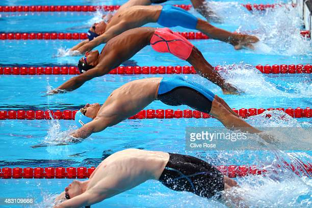 Swimmers dive in to compete in the Men's 200m Backstroke heats on day thirteen of the 16th FINA World Championships at the Kazan Arena on August 6...