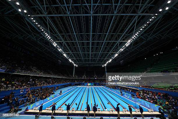 Swimmers dive in to star the semifinal of the Women's 50m Freestyle on Day 7 of the Rio 2016 Olympic Games at the Olympic Aquatics Stadium on August...