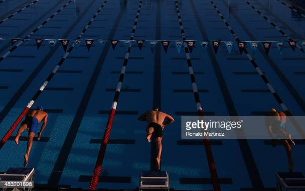 Swimmers dive in to start the Men's 100 LC Meter Breaststroke final during the 2015 Phillips 66 National Championships at the Northside Swim Center...