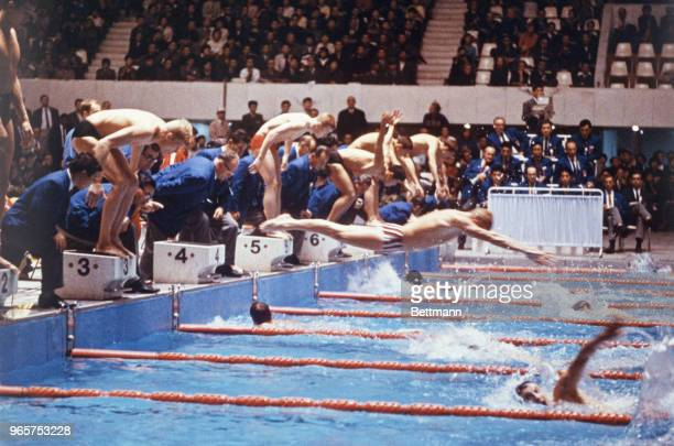 Swimmers dive into the water in the Men's 4x200 Meter Relay. The U.S. Placed first in this event.