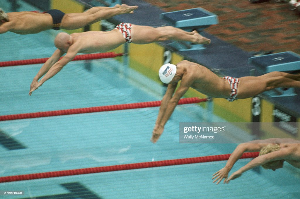 Swimmers Dive Off The Starting Blocks For A Butterfly Stroke Race At The  1976 Olympics In