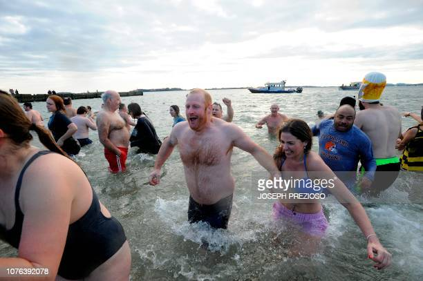 Swimmers enter and exit the water during the annual L Street Brownies New Year's Day Plunge at the Curley Community Center in South Boston...