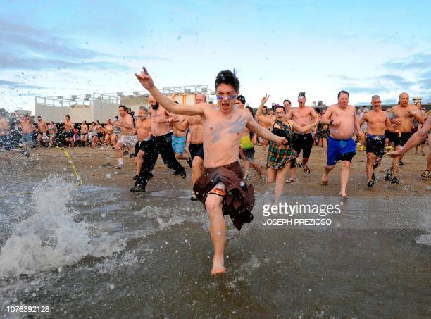 Swimmers enter the water during the annual L Street Brownies New Year's Day Plunge at the Curley Community Center in South Boston Massachussets on...