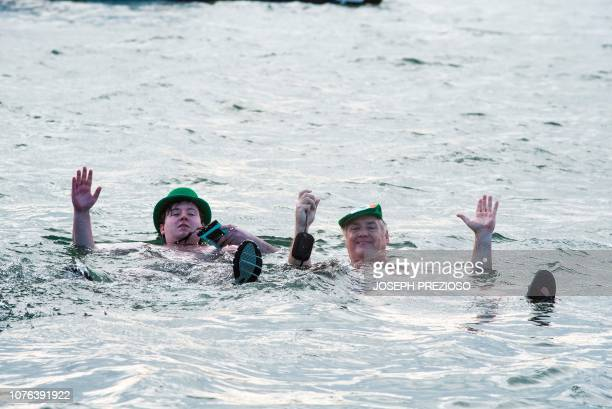 Swimmers float during the annual L Street Brownies New Year's Day Plunge at the Curley Community Center in South Boston Massachussets on January 1...