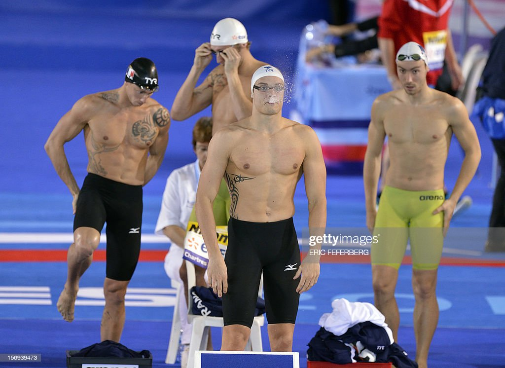 Swimmers from France's team, Florent Manaudou (C), Frederick Bousquet (L), Amaury Leveaux (Top back C) and Jeremy Stravius (R) prepare before the start of the men's short course 4X50m freestyle final at the European Swimming Championships on November 25, 2012, in Chartres. The French team won the gold.