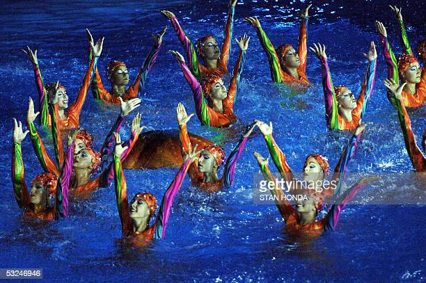 Swimmers from The Cirque du Soleil perform at the opening ceremonies 16 July 2005 for the 2005 XI FINA World Championships that will take place at...