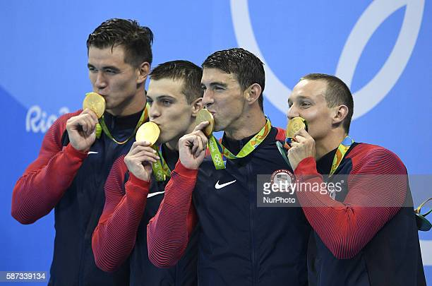 Swimmers from the United States of America attend the awarding ceremony of the swimming final of men's 4x100m freestyle relay at the 2016 Rio Olympic...