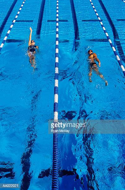 swimmers in marked lanes - young men in speedos stock pictures, royalty-free photos & images