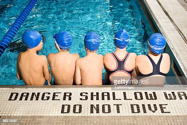 Swimmers in pool waiting