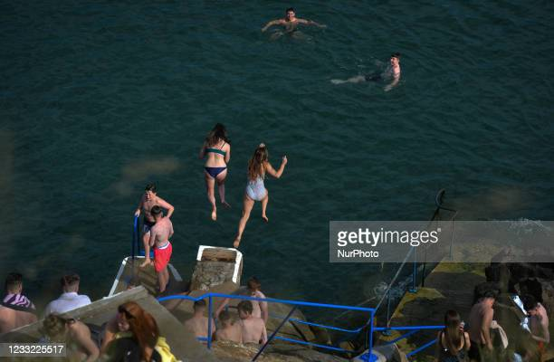 Swimmers jump into the sea at the Vico bathing place, Hawk Cliff, in Dalkey. On Tuesday, 1 June 2021, in Dalkey, Dublin, Ireland.