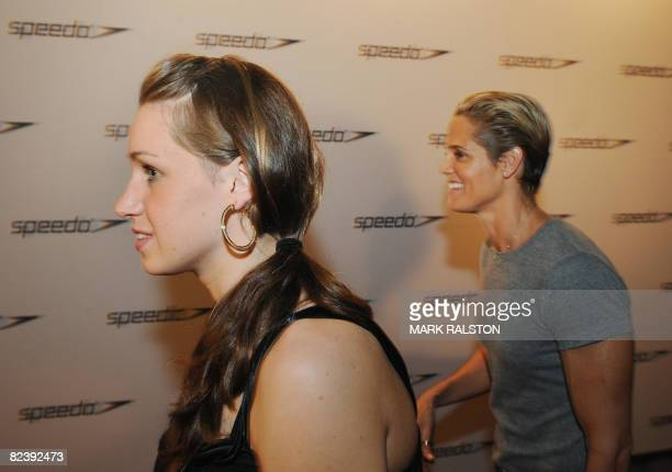 US swimmers Katie Hoff and Dara Torres arrive for a promotional event to celebrate the end of the Olympic swimming programme in Beijing on August 17...