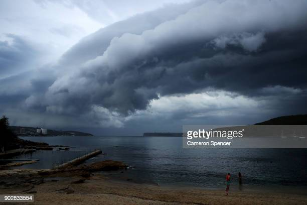 Swimmers leave the water as a storm front crosses Sydney Harbour at Fairlight Beach on January 9 2018 in Sydney Australia Heavy wind rain and severe...