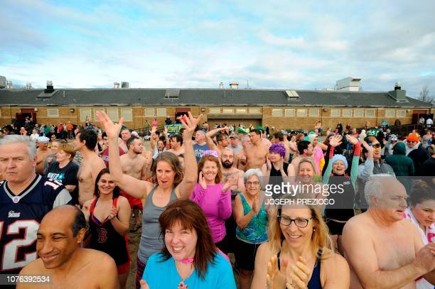 Swimmers line up and start to prepare themselves for the swim during the annual L Street Brownies New Year's Day Plunge at the Curley Community...