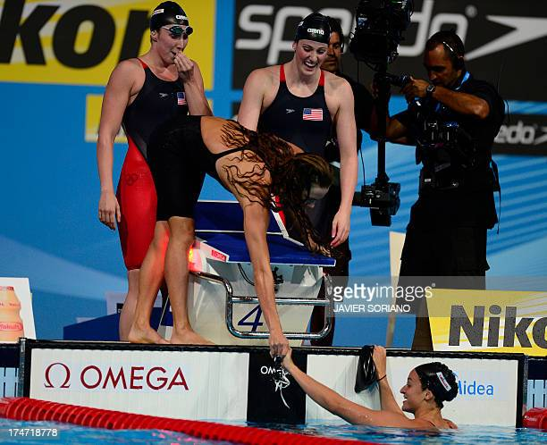 US swimmers Megan Romano Shannon Vreeland Natalie Coughlin and Missy Franklin competes in the final of the women's 4x100metre freestyle relay...