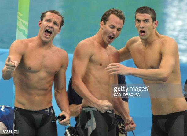 Swimmers Michael Phelps , Aaron Peirsol and Brendan Hansen react during the men's 4 x 100m medley relay swimming final at the National Aquatics...