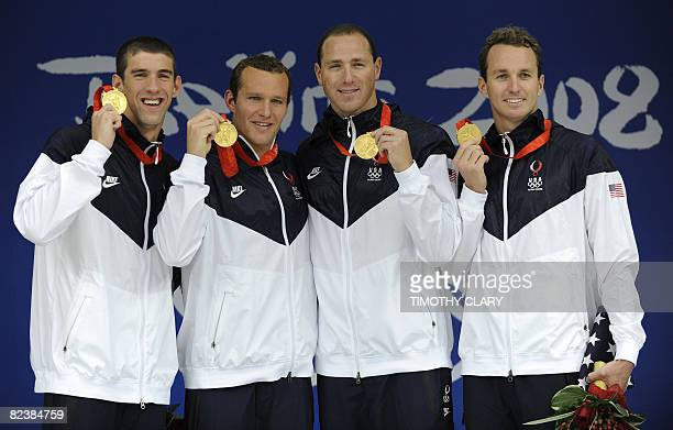 Swimmers Michael Phelps , Brendan Hansen , Jason Lezak , Aaron Peirsol stand on the podium for the men's 4 x 100m medley relay swimming final medal...