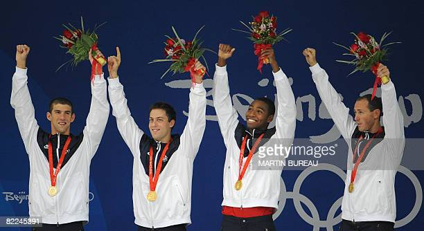 US swimmers Michael Phelps Garrett WeberGale Cullen Jones and Jason Lezak pose on the podium after the men's 4X100m freestyle relay swimming medal...
