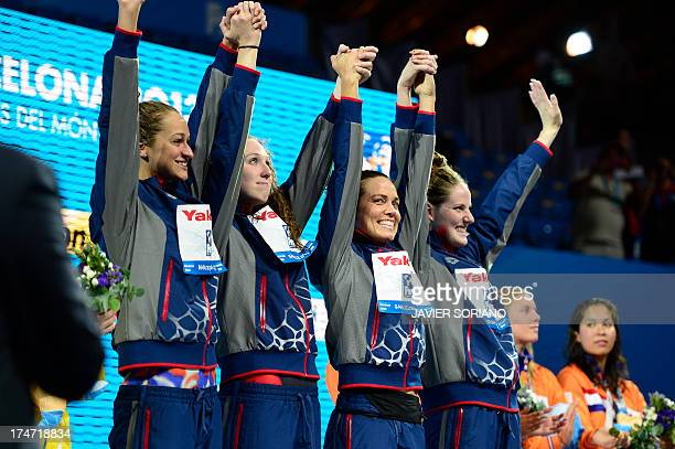 US swimmers Missy Franklin Natalie Coughlin Shannon Vreeland and Megan Romano celebrate on the podium during the award ceremony of the women's...