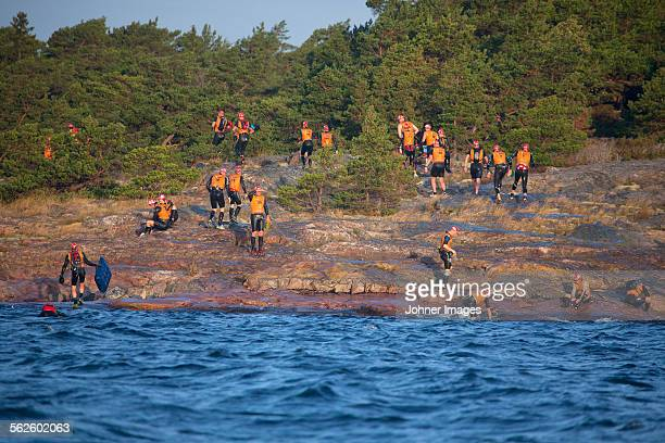 Swimmers on rocky coast