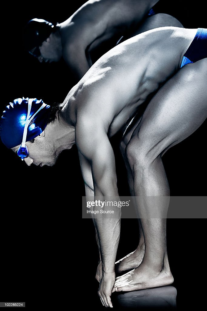 Swimmers on starting block : Stock Photo