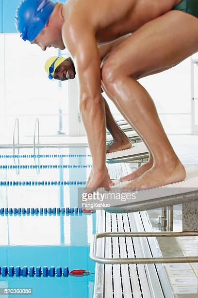swimmers on starting blocks - forward athlete stock pictures, royalty-free photos & images